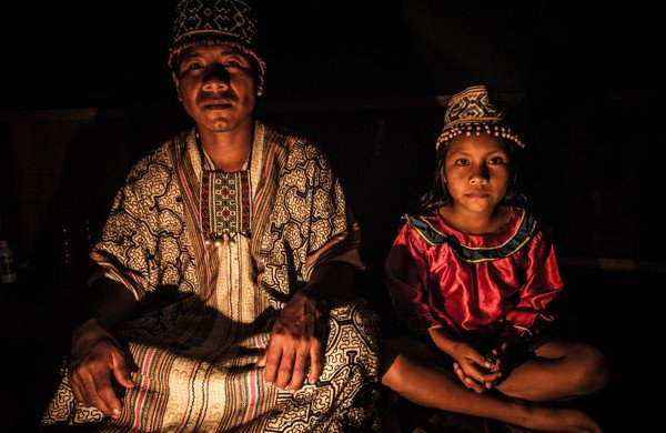 A Bolivian shaman and his daughter preparing to lead the ayahuasca ceremony.